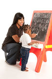 Black Girl and Mom Working in font of Blackboard Stock Photos