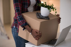 Black girl moving in the new apartment Stock Image