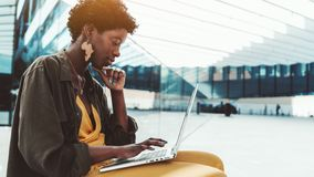 Black girl outdoors with the laptop royalty free stock photography