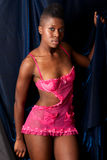 Black girl in pink lingerie Stock Photography