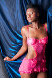 Black girl in pink lingerie Royalty Free Stock Images