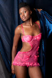 Black girl in pink lingerie Stock Photos