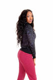 Black girl in pink tights in profile. Royalty Free Stock Photos