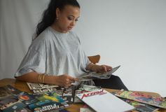 Black girl reading comics stock images
