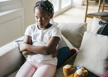 Black girl with sadness emotion stock photo