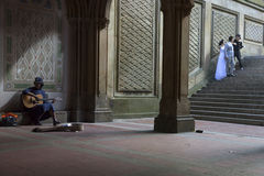 Black girl sings and plays guitar under bethesda arcade in new y. New York City, 14 september 2015: black girl sings and plays guitar under bethesda arcade in royalty free stock images