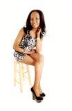 Black girl sitting. Royalty Free Stock Images