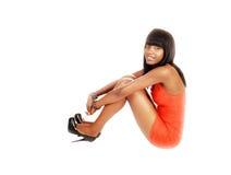 Black girl sitting on floor. Royalty Free Stock Image