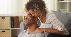 Black girlfriend giving boyfriend massage Royalty Free Stock Photography