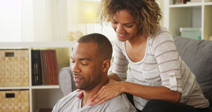 Black girlfriend giving boyfriend massage Stock Photography