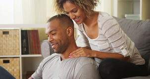 Black girlfriend giving boyfriend neck massage Royalty Free Stock Photos