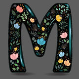 Black Glared Symbol M with Watercolor Flowers Royalty Free Stock Images