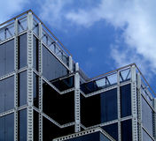 Black glass building. With perforation construction stock image