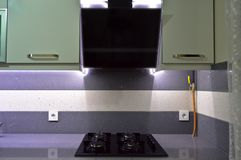 Black glass ceramic gas cooker and paddle box. A modern kitchen paddle box and black glass ceramic gas cooker stock photography
