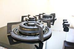 Black glass gas hob. In kitchen stock photo
