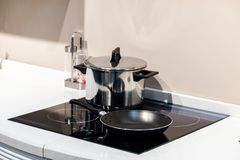 Black glass induction hob in the kitchen royalty free stock photos