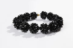 Black glass necklace. On a white background Royalty Free Stock Photography