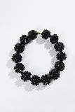 Black glass necklace. On a white background Royalty Free Stock Images