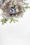 Black glass Xmas bauble and twig on blank paper Stock Image