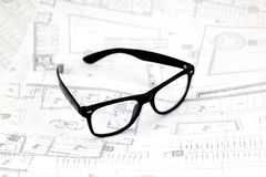 Black glasses on the architectural blueprints Royalty Free Stock Photo
