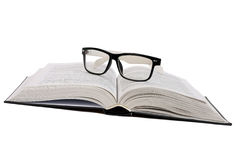 Black glasses on a book Royalty Free Stock Photos