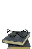 Black glasses on a book Stock Images