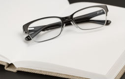 Black glasses on book Royalty Free Stock Photo