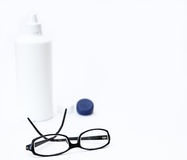 Black glasses and contact lenses. On white background stock photos