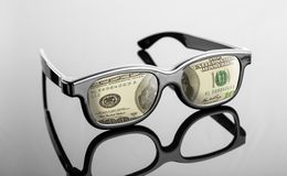 Black glasses with dollars instead of lenses Stock Photo