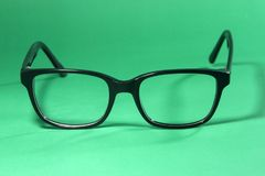 Black glasses on  green Stock Photography