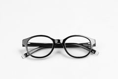 Black glasses. The black glasses on a light background Royalty Free Stock Images