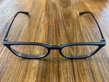 Black glasses on the table background stock images