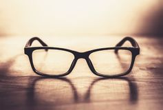 Glasses on the table in warm tone. Black glasses on the table in warm tone Royalty Free Stock Photo