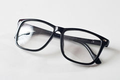 Black glasses on a white background, stock image