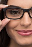 Black glasses woman closeup portrait. Stock Photo
