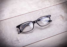 Black glasses on wood  background Stock Photos