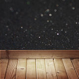 Black glitter lights and wooden floor planks Royalty Free Stock Images
