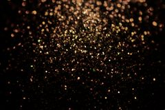 Black glitter sparkle background. Black friday shiny pattern with sequins. Christmas glamour luxury pattern, black. Black red and gold glitter sparkle background stock photo
