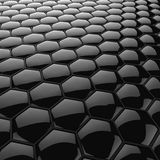 Black glossy honeycomb background. Stock Photos