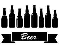 Black glossy isolated beer bottles Stock Photography
