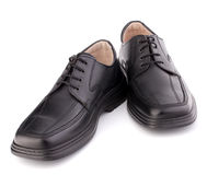 Black glossy man�s shoes with shoelaces Royalty Free Stock Photography