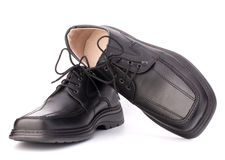 Black glossy man�s shoes with shoelaces Royalty Free Stock Images