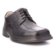Black glossy man's shoe with shoelaces Stock Images