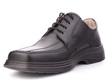 Black glossy man's shoe with shoelaces Royalty Free Stock Photography