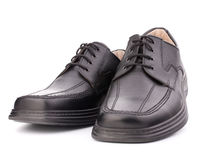 Black glossy man's shoes with shoelaces Royalty Free Stock Image