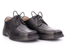 Black glossy man's shoes with shoelaces Stock Image
