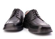 Black glossy man's shoes with shoelaces Stock Photos