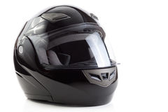 Black, glossy motorcycle helmet. Black flip up helmet for racing motorbike sports Royalty Free Stock Photography