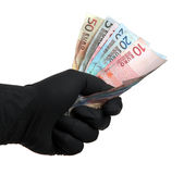 Black glove with european bank notes Royalty Free Stock Photo