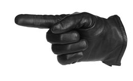 A black glove pointing Stock Images